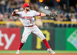 Jun 15, 2018; Pittsburgh, PA, USA; Cincinnati Reds second baseman Jose Peraza (9) throws a ball to first base during the eighth inning against the Pittsburgh Pirates at PNC Park. Mandatory Credit: Ben Queen-USA TODAY Sports