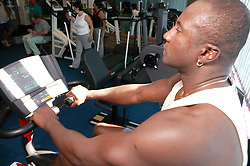 Access to services, Disabled man in the gym; using Recumbent Cycle,