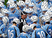 Johns Hopkins head coach Dave Pietramala talks with his team during the game against the Virginia Cavaliers in Charlottesville, VA. Johns Hopkins defeated Virginia 11-10 in overtime. Photo/Andrew Shurtleff