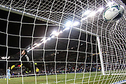 Sporting KC defender Matt Besler (5) scores during penalty kicks during the MLS Cup finals between Real Salt Lake and Sporting KC. Sporting Kansas City outlasted Real Salt Lake in a league-record 10 rounds of penalty kicks and won the second MLS Cup in franchise history.