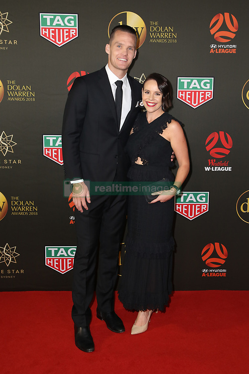 Players from the Westfield W-League and Hyundai A-League arrive on the red carpet for the 2018 Dolan Warren Awards at The Star Event Centre - 80 Pyrmont St, Pyrmont, NSW. 30 Apr 2018 Pictured: Nigel Boogaad, Newcastle Jets captain and Kerryn Boogard. Photo credit: Richard Milnes / MEGA TheMegaAgency.com +1 888 505 6342