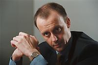 18 JAN 2001, BERLIN/GERMANY:<br /> Friedrich Merz, CDU, CDU/CSU Fraktionsvorsitzender, waehrend einem Interview, in seinem Buero, Deutscher Bundestag, Reichstagsgebaeude<br /> IMAGE: 20010118-01/02-32