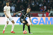 Dani Alves of Paris Saint-Germain battles with Manchester United Forward Marcus Rashford during the Champions League Round of 16 2nd leg match between Paris Saint-Germain and Manchester United at Parc des Princes, Paris, France on 6 March 2019.