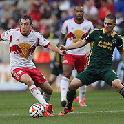 Eric Alexander, (left), New York Red Bulls, challenged by Will Johnson, Portland Timbers, during the New York Red Bulls Vs Portland Timbers, Major League Soccer regular season match at Red Bull Arena, Harrison, New Jersey. USA. 24th May 2014. Photo Tim Clayton
