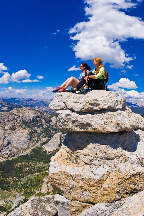 Climbers on the summit of Tenaya Peak, Tuolumne Meadows, Yosemite National Park, California USA