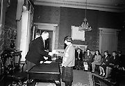 28/04/1966<br /> 04/28/1966<br /> 28 April 1966<br /> President Eamon de Valera presents prizes at Aras an Uachtarain. The President presented the prizes to the winners of competitions for schoolchildren organised by the Golden Jubilee 1916 Committee. The winners from schools all over Ireland competed in competitions for essays and poetry in Irish and English. Picture shows President de Valera presenting 1st prize of £25 in Irish Essay competition to Sile Nic Ghearailt, Ceapach, BreanDán, Tráilí, Co. Chiarraí, a pupil of Colaiste Íde, Daingean Uí Chuise.