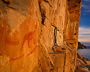 Agawa Rock pictographs of canoe, two serpents with legs and Mishipizhew, the great horned lynx, Ojibwa in origin, Lake Superior Provincial Park, Ontario, Canada.