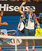 Bernard Tomic (AUS) faced R. Nadal (ESP) in day two play of the 2014 Australian Open at Melbourne's Rod Laver Arena. Here, Nadal watches as Tomic leaves the court after forfeited the match blaming leg pain giving Nadal the win. One set was completed during match play with Nadal up 6-4.