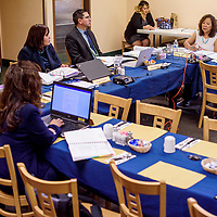 Navajo Housing Authority board members and officials conduct a meeting at the Quality Inn in Window Rock Wednesday.