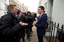 © London News Pictures. 27/03/2013 . London, UK.   Former British Foreign Secretary, David Miliband, brother of Labour Leader Ed Miliband, speaking to media outside his London home after he resigned as the MP for South Shields to take up a role for US based charity International Rescue Committee in New York. Photo credit : Ben Cawthra/LNP