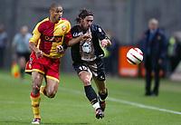 Fotball<br /> Frankrike 2004/05<br /> Lens v Ajaccio<br /> 2. oktober 2004<br /> Foto: Digitalsport<br /> NORWAY ONLY<br /> FABIEN LAURENTI (AJA) / DANIEL COUSIN (LENS)