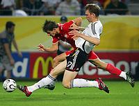 v.l. Per Mertesacker, Ebi Smolarek Polen<br /> Fussball WM 2006 Deutschland - Polen<br /> Tyskland - Polen<br /> Norway only