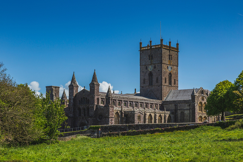 """St David's Cathedral. Based around a monastic community founded by St David in the 6th century this cathedral was built by King Henry I of England in 1115. In 1123 Pope Calixtus II granted a papal privilege upon St Davids, making it a centre of pilgrimage for the Western world, the Pope decreeing that """"Two pilgrimages to St Davids is equal to one to Rome, and three pilgrimages to one to Jerusalem""""."""