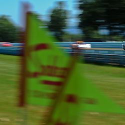 July 1, 2012 - The Action Express Corvette DP driven by Terry Borcheller and David Donahue drives past Sahlen's pennants on the back straightaway during The Grand-Am Rolex Sports Car Series Sahlen's Six Hours of the Glen.