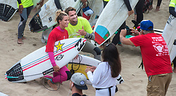 June 20, 2017 - Huntington Beach, California, USA - Pro surfers Courtney Conlogue, left, of Santa Ana and Brett Simpson of Huntington Beach pose for a photograph as they wait with nearly 600 surfers to make their way into  the ocean to create the world's largest paddle out ''Circle of Honor'' in Huntington Beach Tuesday morning, June  20, 2017. (Photo by Mark Rightmire, Orange County Register/SCNG) (Credit Image: © Mark Rightmire, Mark Rightmire/The Orange County Register via ZUMA Wire)