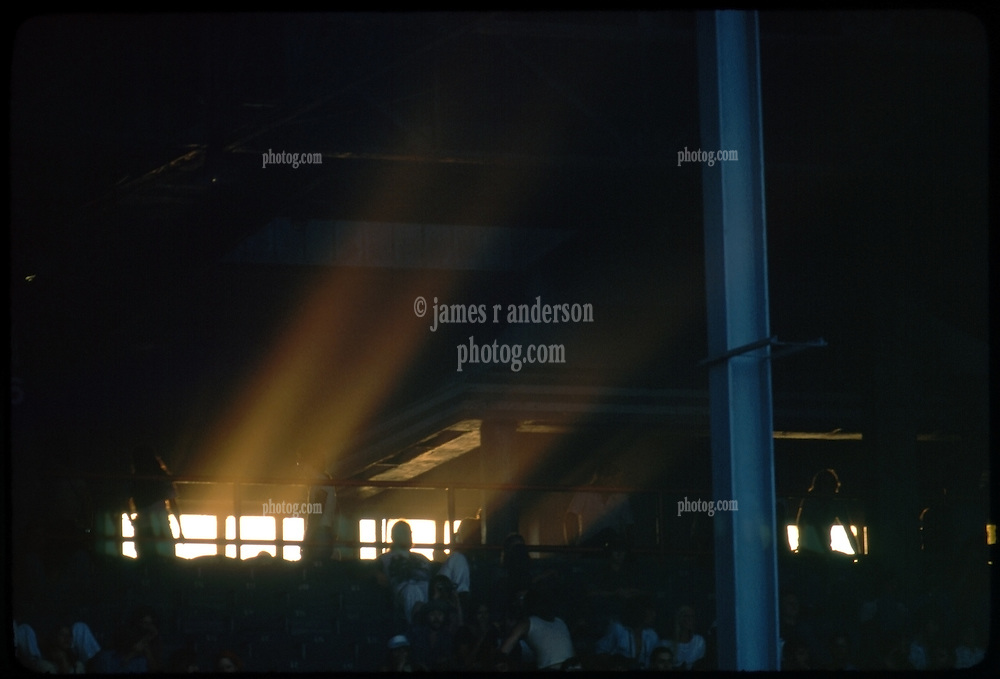 Sun streams in the old west wall windows of Roosevelt Stadium before the Grateful Dead Concert begins on 4 August 1976.