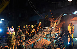(160331) -- KOLKATA, March 31, 2016 () -- Rescuers work at the collapse site of an under-construction flyover in Kolkata, capital of eastern Indian state West Bengal, March 31, 2016.At least 20 people have been killed and more than 150 others injured in a under-construction flyover collapse in the eastern Indian city of Kolkata Thursday. EXPA Pictures © 2016, PhotoCredit: EXPA/ Photoshot/ Bi Xiaoyang<br /> <br /> *****ATTENTION - for AUT, SLO, CRO, SRB, BIH, MAZ, SUI only*****