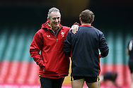 Wales coach Robert Howley speaks to Leigh Halfpenny of Wales . Wales Rugby captains run, ahead of tomorrows RBS Six nations match against England. Principality Stadium, Cardiff, South Wales on Friday 10th Feb 2017.   pic by  Andrew Orchard, Andrew Orchard sports photography.