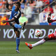 Yannick Djalo, (left), San Jose Earthquakes, shoots past Ibrahim Sekagya, New York Red Bulls, during the New York Red Bulls Vs San Jose Earthquakes, Major League Soccer regular season match at Red Bull Arena, Harrison, New Jersey. USA. 19th July 2014. Photo Tim Clayton