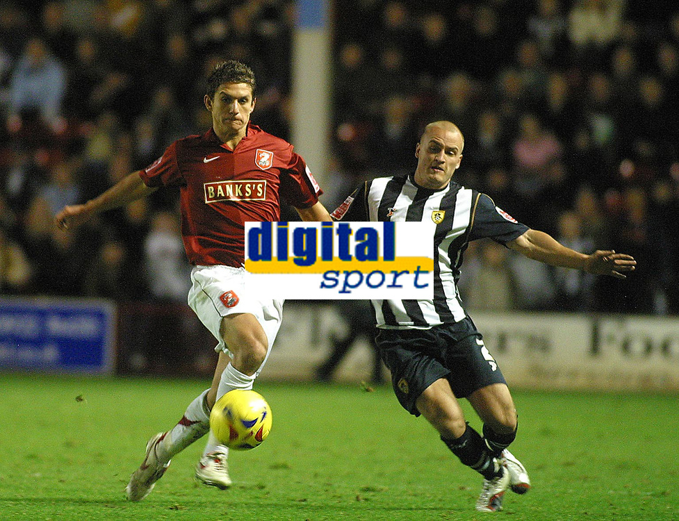 Photo: Dave Linney.<br />Walsall v Notts County. Coca Cola League 2. 25/11/2006.<br />Walsall' Kris Taylor(L) battles with   David Pipe