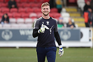 AFC Wimbledon goalkeeper George Long (1) warming up during the EFL Sky Bet League 1 match between AFC Wimbledon and Oxford United at the Cherry Red Records Stadium, Kingston, England on 10 March 2018. Picture by Matthew Redman.