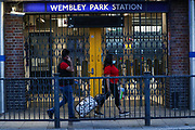 "People wearing face masks walk by the closed Gates of Wembley Park Station in London after British Transport Police responded to an incident on Monday, Sept 14, 2020.  BTP also brought dog units at the station following the incident, but they wouldn't give any details about the incident other than that they were after a suspect who was alleged to have been in one of the Jubilee Line trains. People in twitter were complaining about TFL staff quote: ""The staff are useless, just kicking people off of trains with no explanation. Empty trains going towards Wembley."" (VXP Photo/ Vudi Xhymshiti)"
