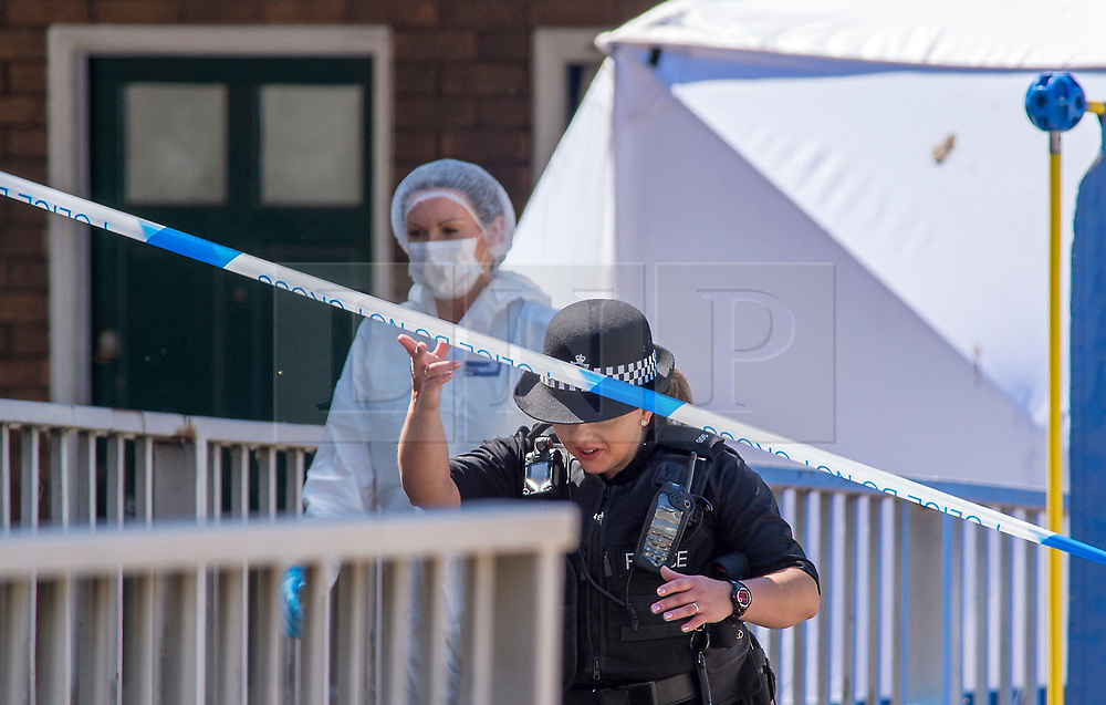 © Licensed to London News Pictures.  25/06/2018; Bristol, UK. Scene of murder with police and forensics. A murder investigation has been launched after man dies and two are seriously injured in an armed burglary in Prewett Street, Redcliffe, in the early hours of the morning. It is reported that neighbours have told of hearing bloodcurdling screams of as three men were attacked with a sword-like knife. Two other men who suffered life-threatening injuries have been taken to hospital. It is reported that two men from London have been arrested in connection with the incident. Photo credit: Simon Chapman/LNP
