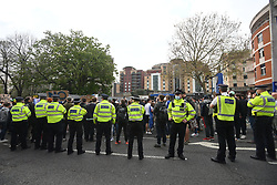 © Licensed to London News Pictures. 20/04/2021. London, UK. Fans gather outside of Stamford Bridge in West London ahead of the Premiere League game between Chelsea and Brighton, to demonstrate against plans for a European Super League. There has been widespread hostility towards proposals for a new elite league of European football clubs, which opponents say will kill competition and damage the sport. Photo credit: Ben Cawthra/LNP