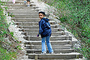 Child (9 years old) at base of steps, Krka National Park, Croatia