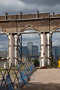 Construction site frames Canary Wharf financial district in East London.
