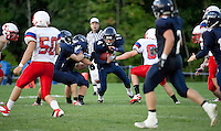 Merrimack Valley running back Justin Abbot maneuvers for some yardage during their Friday Night Football matchup with Trinity High School.  (Karen Bobotas/for the Concord Monitor)Friday Night Football Merrimack Valley High School versus Trinity High School in Concord, NH September 2, 2011.  (Karen Bobotas/for the Concord Monitor)