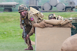 Reenactor of the NWW2A Portraying a paratrooper from the US 82nd Airborne Division during a battle reenactment at Fort Paull on Sunday ..5 May 2013.Image © Paul David Drabble