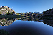 Perfect reflections in Lago de la Ercina in the Picos de Europa in northern Spain