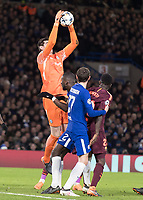 Football - 2017 / 2018 UEFA Champions League - Round of Sixteen, First Leg: Chelsea vs. Barcelona<br /> <br /> Thibaut Courtois (Chelsea FC)  rises high to collect the cross at Stamford Bridge.<br /> <br /> COLORSPORT/DANIEL BEARHAM
