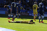 Nadjim Abdou of Millwall © lies on the ground as he has a shot on goal blocked. Skybet football league championship, Cardiff city v Millwall at the Cardiff city stadium in Cardiff, South Wales on Saturday 18th April 2015<br /> pic by Andrew Orchard, Andrew Orchard sports photography.