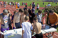 Central Valley, New York - Runners check for their results at the Woodbury Country Ramble race on Aug. 26, 2012.