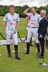 Left to right, PRINCE HARRY and HRH THE DUKE OF CAMBRIDGE at the Audi Polo Challenge at Coworth Park, Blacknest Road, Ascot, Berkshire on 31st May 2015.