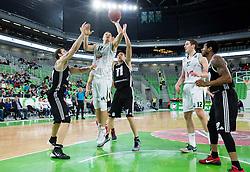 Dino Muric #14 of KK Union Olimpija vs Arturs Strelnieks of Riga  during basketball match between KK Union Olimpija (SLO) and BC VEF Riga (LAT) in 10th Round of Regular Season of EuroCup 2014/15, on December 17, 2014 in Arena Stozice, Ljubljana, Slovenia. Photo by Vid Ponikvar / Sportida