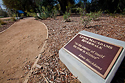 Plaque commemorating Lewis MacAdams, Los Angeles River advocate and cofounder of FoLAR, Friends of the Los Angeles River. Sunnynook Park, Glendale Narrow, Los Angeles, California, USA