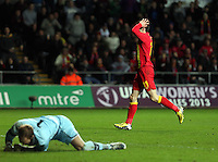Pictured: Gareth Bale of Wales (R) is holding his head in his hands after his shot goes wide, goalkeeper Robert Almer of Austria is on the ground (L). Wednesday 06 February 2013..Re: Vauxhall International Friendly, Wales v Austria at the Liberty Stadium, Swansea, south Wales.