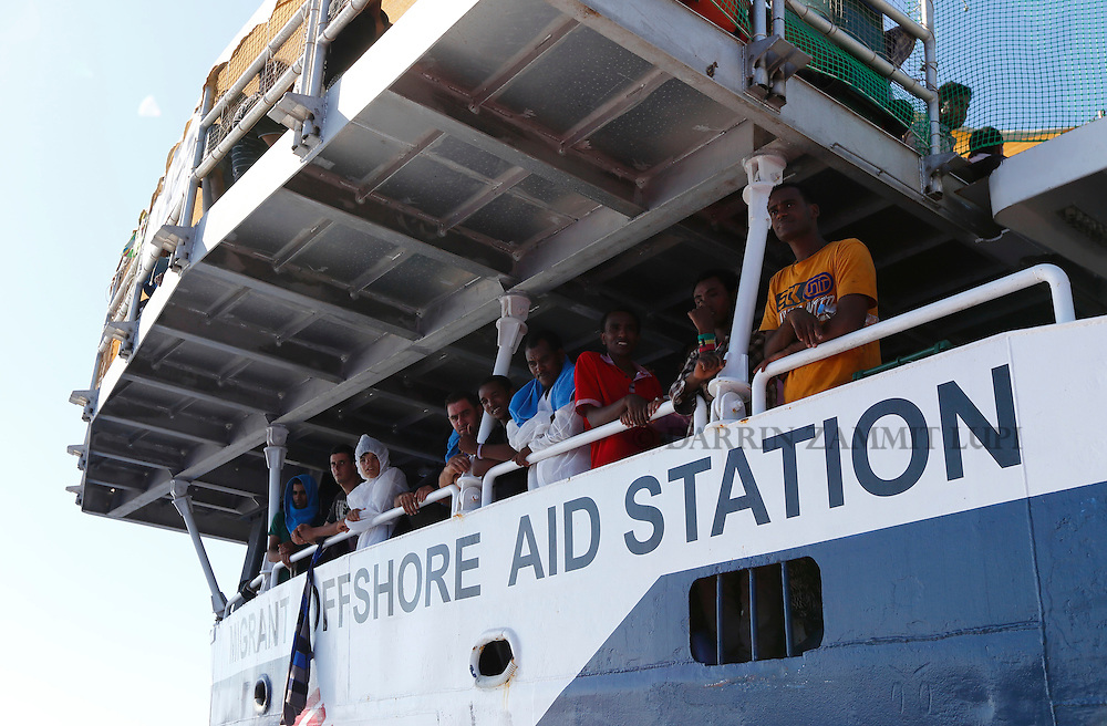 Migrants look out from the Migrant Offshore Aid Station (MOAS) ship MV Phoenix after being rescued from an overloaded wooden boat 10.5 miles (16 kilometres) off the coast of Libya August 6, 2015.  An estimated 600 migrants on the boat were rescued by the international non-governmental organisations Medecins san Frontiere (MSF) and MOAS without loss of life on Thursday afternoon, according to MSF and MOAS, a day after more than 200 migrants are feared to have drowned in the latest Mediterranean boat tragedy after rescuers saved over 370 people from a capsized boat thought to be carrying 600.<br /> REUTERS/Darrin Zammit Lupi <br /> MALTA OUT. NO COMMERCIAL OR EDITORIAL SALES IN MALTA