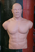 a muscular boxing punch dummy in a boxing school