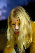 Young girl with tiger makeup mask is getting ready for Purim. model released