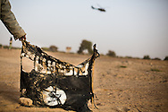 A man displays a tattered Al Qaeda flag in Timbuktu on Feb. 1, 2013 days after French forces drove out Al Qaeda soldiers who had taken the town.