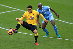 27 November 2016 - Premier League - Watford v Stoke City - Troy Deeney of Watford in action with Bruno Martins Indi of Stoke City - Photo: Marc Atkins / Offside.