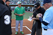 16 May 2016: Notre Dame head coach Mik Aoki (in green) waits as UNC head coach Mike Fox (right) presents his lineup to home plate umpire Olindo Matia (second from right). The University of North Carolina Tar Heels hosted the University of Notre Dame Fighting Irish in an NCAA Division I Men's baseball game at Boshamer Stadium in Chapel Hill, North Carolina.