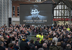 © Licensed to London News Pictures. 01/02/2017. Watford, UK. Mourners and fans applaud as the coffin of England football team manager Graham Taylor leaves St Mary's Church in Watford, Hertfordshire after his funeral. The former England, Watford and Aston Villa manager,  who later went on to be chairman of Watford Football Club, died at the age of 72 from a suspected heart attack. Photo credit: Peter Macdiarmid/LNP