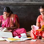 CAPTION: Every self-help group (SHG) has various office-bearing positions, including chairperson (right) and treasurer (left). LOCATION: Doddarayapete (village), Kasaba (hobli), Chamrajnagar (district), Karnataka (state), India. INDIVIDUAL(S) PHOTOGRAPHED: Left: Suvarna; right: Shobha.