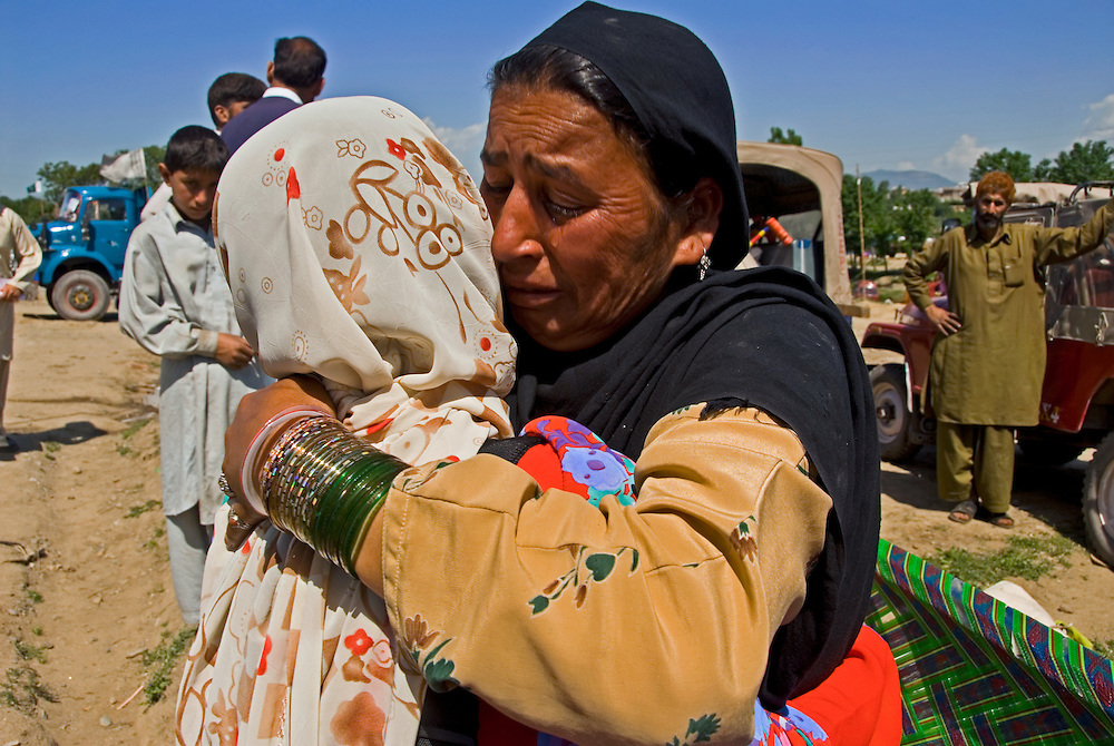 Rozina Swati, an earthquake survivor in Pakistan, tearfully bids farewell to a CWS friend in the refugee camp before returning to her village.