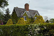 A rural mansion is covered in ivy, in Beningbrough, Yorkshire, England, United Kingdom.